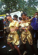 Two girls dressed in gold dancing at Notting Hill Carnival, 1993.