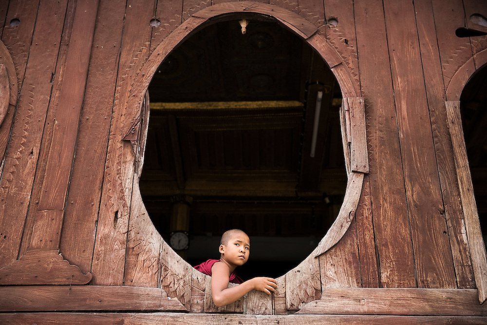 young monk having some rest, small monastery near the Inle lake, Myanmar