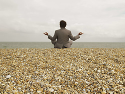 Jun. 19, 2007 - Businessman in Yoga Position on Beach.. Model Released (MR) (Credit Image: © Cultura/ZUMAPRESS.com)