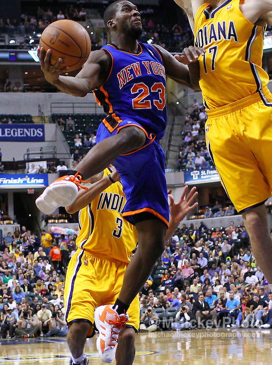 April 03, 2012; Indianapolis, IN, USA; New York Knicks point guard Toney Douglas (23) shoots the ball against the Indiana Pacers at Bankers Life Fieldhouse. Indiana defeated New York 112-104. Mandatory credit: Michael Hickey-US PRESSWIRE
