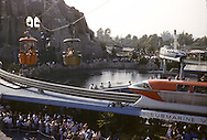 Overall scene of monorail, submarine seen from skyway with matterhorn and gondolas in background. Disneyland vacation Kodachromes from 1962.