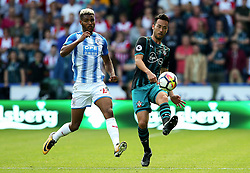 Maya Yoshida of Southampton and Steve Mounie of Huddersfield Town - Mandatory by-line: Matt McNulty/JMP - 26/08/2017 - FOOTBALL - The John Smith's Stadium - Huddersfield, England - Huddersfield Town v Southampton - Premier League