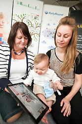 Three generations  Gran Bet Rudge, Mum Kirsty Rudge and young Zac Roberts get to try out the new technology at the Launch of Technology Strategy Board, Year Zero dallas Community at Rotherham NHS Foundation trust on Wednesday morning..23  May 2012.Image © Paul David Drabble