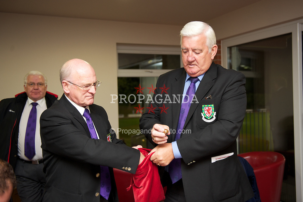 NEWTOWN, WALES - Tuesday, September 14, 2010: Football Association of Wales President Phil Pritchard and FAW Council member Ken Tucker conduct the draw for the Welsh Cup 4th Round during the Under-23 Semi-Pro International Friendly match at Latham Park. (Photo by David Rawcliffe/Propaganda)