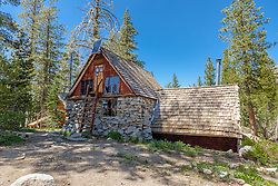 """""""Peter Grubb Hut"""" - Photograph of the Peter Grubb Hut off of the Pacific Crest Trail, near Castle Peak."""