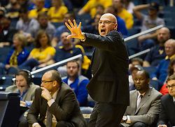 Dec 13, 2015; Morgantown, WV, USA; Louisiana Monroe Warhawks head coach Keith Richard calls out a play during the first half against the West Virginia Mountaineers at WVU Coliseum. Mandatory Credit: Ben Queen-USA TODAY Sports