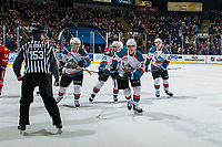 KELOWNA, BC - MARCH 02:  Leif Mattson #28, Schael Higson #21, Kaedan Korczak #6 and Alex Swetlikoff #17 of the Kelowna Rockets skate to the bench to celebrate a third period goal against the Portland Winterhawks at Prospera Place on March 2, 2019 in Kelowna, Canada. (Photo by Marissa Baecker/Getty Images)