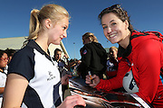Sofia Fenwick of the Tactix signs an autograph for Sophie Allen, 13 of the Southbridge Netball Club during the ANZ Championship Roadshow, Win a Warmup, held at the Selwyn Netball Centre, Lincoln. 17 May 2014 Photo: Joseph Johnson/www.photosport.co.nz
