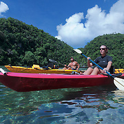 Ron Leidich and Terry Ward paddling by kayak inside Black Tip Lake, a shallow, semi-enclosed bay that is a nursery for baby blacktip reef sharks and other juvenile fish. The sharks use sheltered areas like this one as safe havens to grow and hunt small fish while they mature.