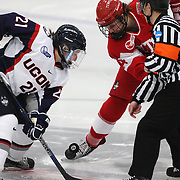 Jordy Zacharias, UConn and Maddie Elia, Boston University, challenge at a face-off during the UConn Vs Boston University, Women's Ice Hockey game at Mark Edward Freitas Ice Forum, Storrs, Connecticut, USA. 5th December 2015. Photo Tim Clayton