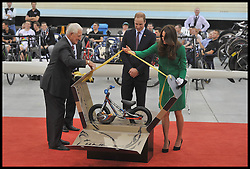 The Duke and Duchess of Cambridge are presented with a cycle for Prince George  as they open the new Cycling Centre of Excellence Velodrome in Hamilton, New Zealand, on day 6 of the  Royal Tour of New Zealand and Australia, Saturday, 12th April 2014. Picture by Andrew Parsons / i-Images