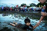 April 30, 2016 - Zeke Harvey, 6, of Memphis, enjoys a pull through the mud from his babysitter, Madison Derousse, of Paducah, KY., as rap group Cypress Hill performs during the youngster's playtime on the second day of the Beale St. Music Festival at Tom Lee Park Saturday. The festival was delayed for a few hours due to weather, but it didn't dampen the mood once the music started. (Yalonda M. James/The Commercial Appeal)