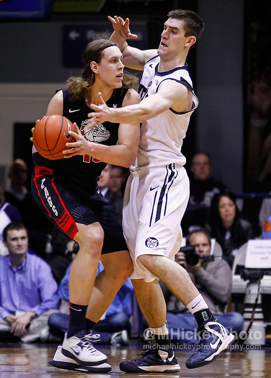 INDIANAPOLIS, IN - JANUARY 19: Kelly Olynyk #13 of the Gonzaga Bulldogs holds the ball as Andrew Smith #44 of the Butler Bulldogs defends at Hinkle Fieldhouse on January 19, 2013 in Indianapolis, Indiana. Butler defeated Gonzaga 64-63. (Photo by Michael Hickey/Getty Images) *** Local Caption *** Kelly Olynyk; Andrew Smith
