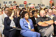Formosa supporters in the front row at Louisiana's Department of Environmental Quality's  public hearing on whether to approve the 15 air permits for Taiwanese company Formosa Plastics in Vacherie, LA. on July 9, 2019. In second row, woman looking downward- Janile Parks, representative of Formosa.