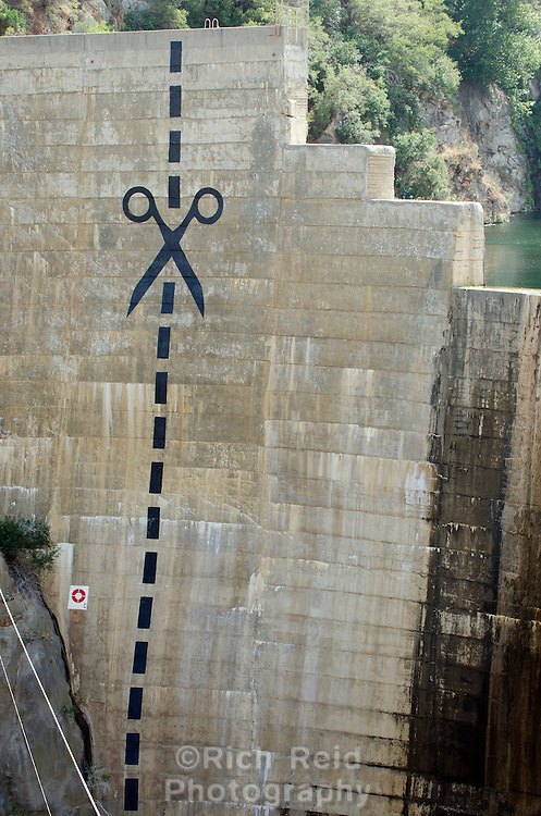 Close-up of scissors and cut marks painted on the obsolete Matilija Dam in Los Padres National Forest near Ojai, California.