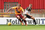 Josh Law intercepts the ball from Niall McGinn  during the Ladbrokes Scottish Premiership match between Motherwell and Aberdeen at Fir Park, Motherwell, Scotland on 15 August 2015. Photo by Craig McAllister.