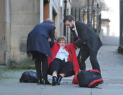 Scottish Labour leader Richard Leonard and newly elected councillor Martin Lennon rush to the aid of former Labour MSP Cathy Peattie after she fell on ice while arriving for the Labour NEC meeting in Glasgow. <br /> <br /> © Dave Johnston/ EEm