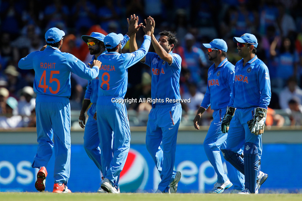 06.03.2015. Perth, Australia. ICC Cricket World Cup. India versus West Indies. Indian players celebrate the wicket of Chris Gayle.