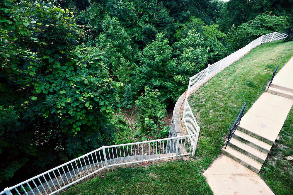 Fence and walkway separating condominiums from forest, Owings Mills, Maryland