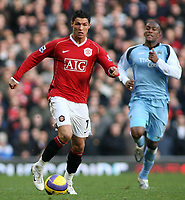 Photo: Paul Thomas.<br /> Manchester United v Manchester City. The Barclays Premiership. 09/12/2006.<br /> <br /> Cristiano Ronaldo (L) of Man Utd races down field past of Sylvian Distin Man City.