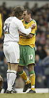 Photo: Aidan Ellis.<br /> Leeds United v Norwich City. Coca Cola Championship. 11/03/2006.<br /> Leeds Sean Derry and Norwich's Andy hughes clash with each other
