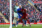 Cardiff City goalkeeper Neil Etheridge (1) Cardiff City midfielder Aron Gunnarsson (17) and Liverpool striker Sadio Mane (10) during the Premier League match between Liverpool and Cardiff City at Anfield, Liverpool, England on 27 October 2018.