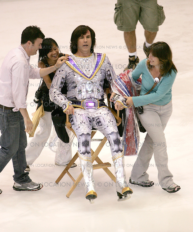 August 30th 2006 Los Angeles, California ***EXCLUSIVE*** Will Ferrell is assisited across the ice rink by crew members on the set of Blades of Glory. Photo by Eric Ford 818-613-3955 info@onlocationnews.com