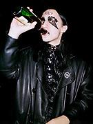 Marilyn Manson fan drinking beer outside the London Arena, London, 2001.