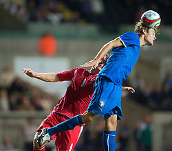 SWANSEA, ENGLAND - Friday, September 4, 2009: Wales' Sam Vokes and Italy's Gabriele Angella during the UEFA Under 21 Championship Qualifying Group 3 match at the Liberty Stadium. (Photo by David Rawcliffe/Propaganda)
