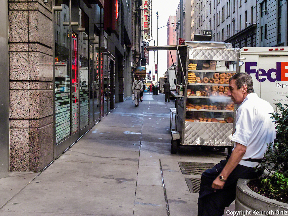 It's early morning in Times Square, New York City and a man smokes his cigarette before he gets his day started.