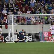 Harrison Shipp, (left), Chicago Fire, completes his hat trick as he beats New York Red Bulls goalkeeper Luis Robles during the New York Red Bulls Vs Chicago Fire, Major League Soccer regular season match won 5-4 by the Chicago Fire at Red Bull Arena, Harrison, New Jersey. USA. 10th May 2014. Photo Tim Clayton