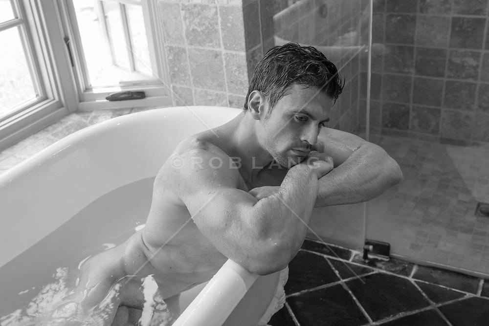 hot man relaxing in a bathtub