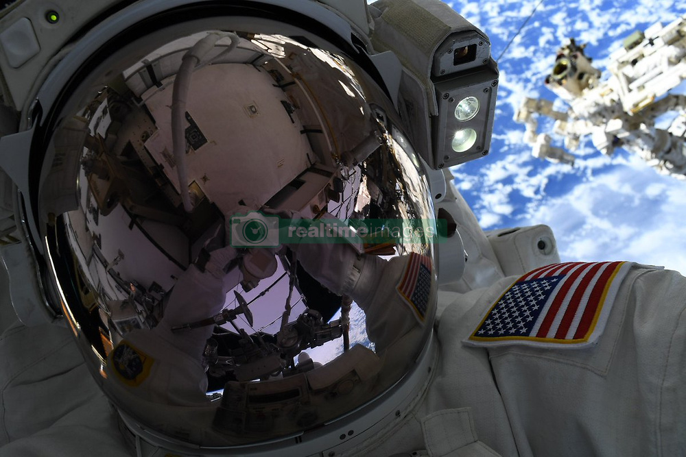 March 25, 2019 - Earth Atmosphere - Image Released Today: NASA astronaut NICK HAGUE completed the first spacewalk of his career on Friday, March 22, 2019. He and fellow astronaut Anne McClain worked on a set of battery upgrades, on the International Space Station's starboard truss. In a Facebook post, he wrote: 'Big thank you to the ground team down in Mission Control at NASA's Johnson Space Center, who supported Anne and I with our first #spacewalk on Friday. They are the ones who really make it possible to walk among the stars.' (Credit Image: © NASA/ZUMA Wire/ZUMAPRESS.com)