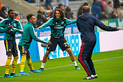 Matteo Guendouzi (#29) of Arsenal FC is all smiles as he warms up with team mates during the Premier League match between Newcastle United and Arsenal at St. James's Park, Newcastle, England on 11 August 2019.