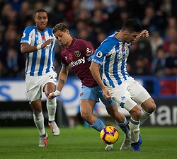 Javier Hernandez of West Ham United (L) and Christopher Schindler of Huddersfield Town in action - Mandatory by-line: Jack Phillips/JMP - 10/11/2018 - FOOTBALL - The John Smith's Stadium - Huddersfield, England - Huddersfield Town v West Ham United - English Premier League