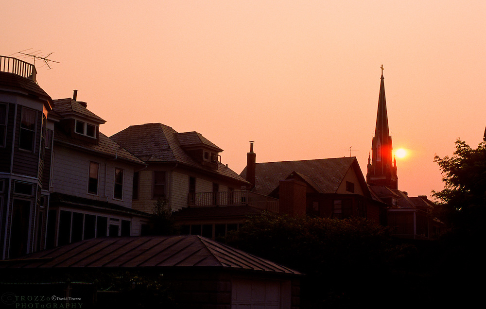 Annapolis, Maryland--Homes and the tower of St. Mary's Catholic Church at sunset. St. Mary's, a Gothic style church in the Historic District of Annapolis was built on the property of a Revolutionary patriot. The church was concencrated in 1860.