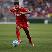 Emre Can, Liverpool, in action during the Liverpool Vs AS Roma friendly pre season football match at Fenway Park, Boston. USA. 23rd July 2014. Photo Tim Clayton