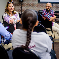 Ian Ton, left, talks with Kyla Powell and other guests during the Native American Baha'i Institute of Learning Coaches Gathering at El Morro Event Center in Gallup Tuesday.