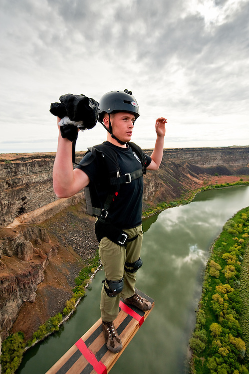 Base jumper on the Perrine Bridge spanning the Snake River in South Central Idaho gets ready to plunge of 486 feet (148 m) to the canyon floor at the only location in United States where base jumping is allowed year-round without a permit MR.
