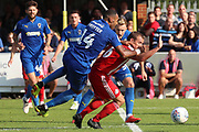 Sunderland midfielder Lee Cattermole (6) fouling AFC Wimbledon midfielder Liam Trotter (14) during the EFL Sky Bet League 1 match between AFC Wimbledon and Sunderland at the Cherry Red Records Stadium, Kingston, England on 25 August 2018.