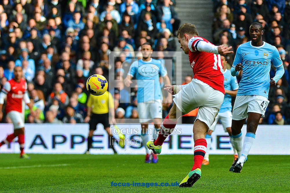 Picture by Ian Wadkins/Focus Images Ltd +44 7877 568959<br /> 14/12/2013<br /> Jack Wilshere shoots at goal during the Barclays Premier League match at the Etihad Stadium, Manchester.