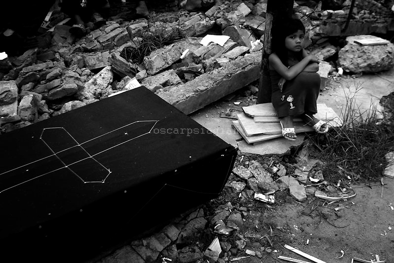 A coffin is prepared for a victim of the Sumatra earthquake on October 4, 2009 in Padang, Indonesia. An earthquake of magnitude 7.6 struck at 5.16pm local time 85km under the sea north-west of Padang on September 30. According to reports officials have reported a death toll of 700 in the port city of Padang. However, that is expected to rise to over 1,000