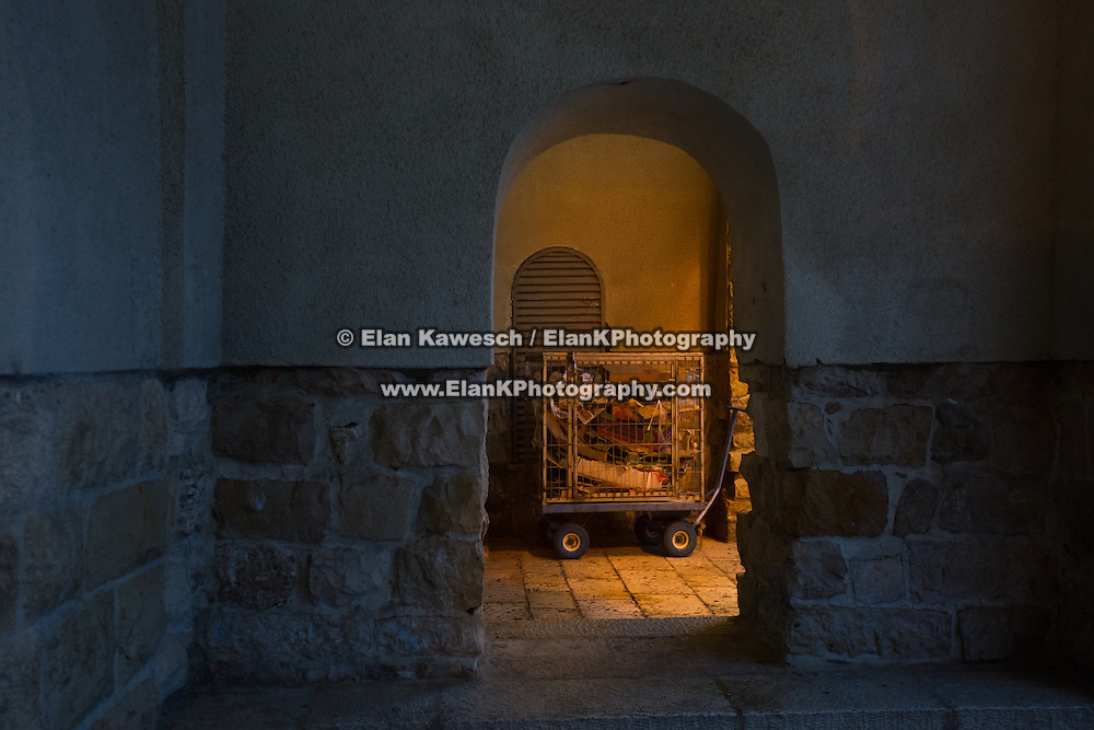 A garbage cart is seen in The Rova area of The Old City on January 7, 2015 in Jerusalem, Israel. (Photo by Elan Kawesch)