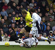 28/02/2004  -  Nationwide Div 1 Watford v Wimbledon.Watford's Lee Cook breaks through down the Wimbledon defenders, to set up a second half attack.