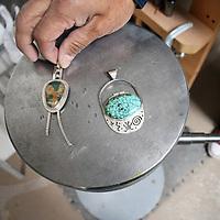 Some of Zuni silversmith Carlton Jamon's work on display at his studio in Zuni Wednesday.