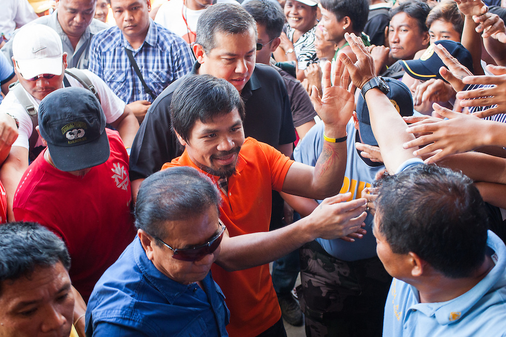Manny Pacquiao greets the crowd as he arrives at Tacloban City Astrodome Convention Center.<br /> <br /> Manny Pacquaio visits victims of Typhoon Yolanda in Tacloban City.  Leyte, Philippines  December 2, 2013