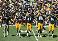 September 22 2012: Iowa Hawkeyes captains, cornerback Micah Hyde (18), linebacker James Morris (44), offensive linesman James Ferentz (53), and quarterback James Vandenberg (16) walk to the center of the field for the coin toss before the start of the NCAA football game between the Central Michigan Chippewas and the Iowa Hawkeyes at Kinnick Stadium in Iowa City, Iowa on Saturday September 22, 2012. Central Michigan defeated Iowa 32-31.