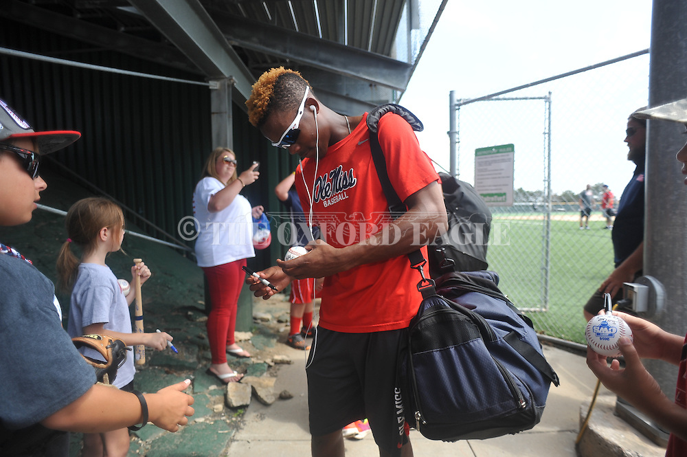 Mississippi's Errol Robinson (6) signs autographs after practice at Creighton University in Omaha, Neb. on Wednesday, June 18, 2014.