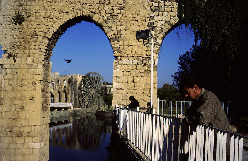 Syria, habitants of Hama walk by the banks of Orontes river were its possible to find two giant water wheels.