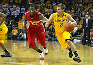 January 27, 2010: Iowa guard Cully Payne (3) is chased by Ohio State guard William Buford (44) during the second half of their game at Carver-Hawkeye Arena in Iowa City, Iowa on January 27, 2010. Ohio State defeated Iowa 65-57.